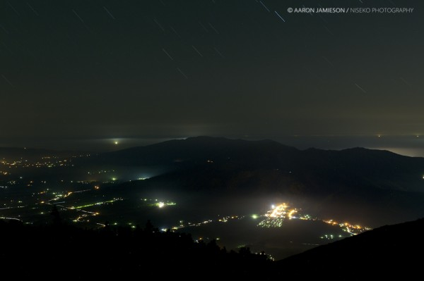 Hirafu at night, running back to the sea of Japan with the squid boats on the horizon