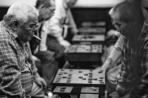 Old men playing shogi (Japanese style chess) in Osaka.