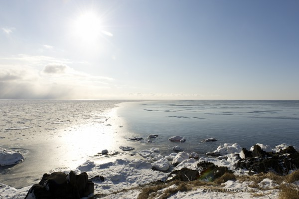 Sea ice meets ocean waters on Japan's most easterly point. Russia in the distance.
